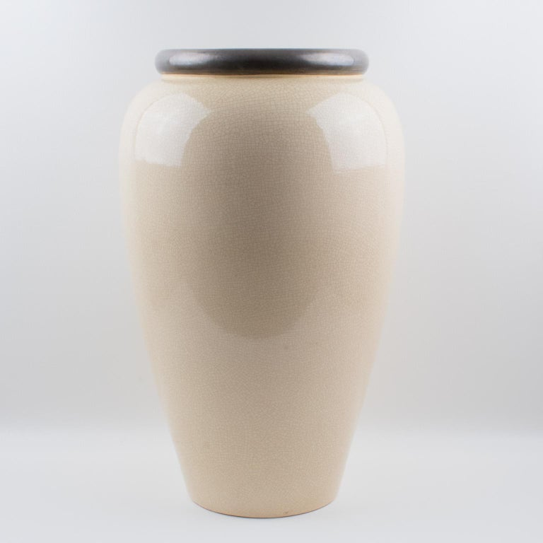 Exquisite Art Deco tall vase or umbrella stand by Faiencerie Saint Clement. French ceramic vase with off-white crackle glaze finish. Features an impressive Amphora shape with antique silver enamel collar. The crackle clear glaze was a popular