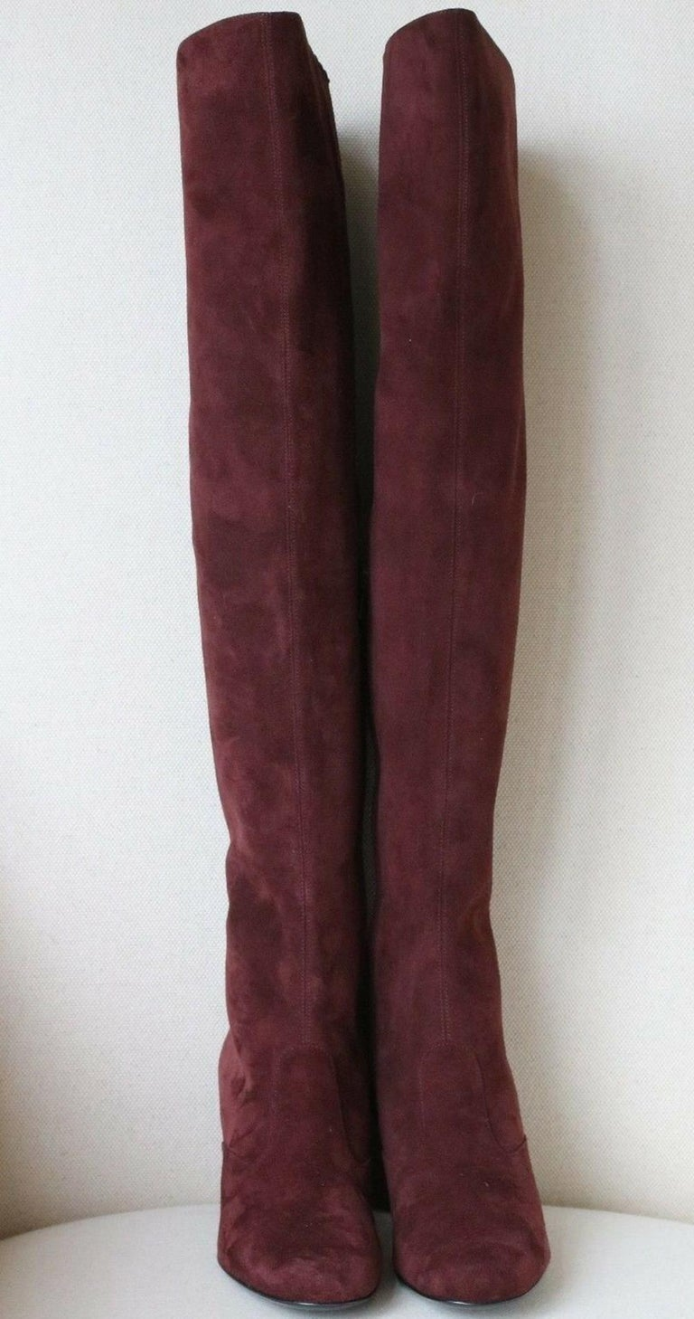 The knee-high boot is a season essential, and Saint Laurent champions the style with these brand new block-heel. They're made from burgundy lamb-suede and shaped with a vintage-inspired square toe and a small, chunky heel. 100% Lambskin.  Size: EU