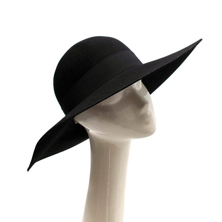 Saint Laurent Black Feather and Grosgrain-trimmed Hat   - Wide-brimmed  - Black rabbit-felt  - Feather detail - 70s aesthetic  - Round top  Materials: Hat: - 100% rabbit-felt  Feather: - 100% Pheasant  Ribbon: - 56% Cotton - 44% Viscose  Spot