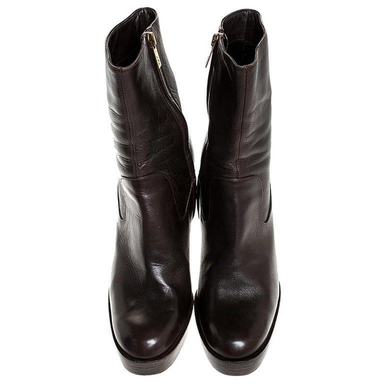 Exclusively crafted by the best, these boots are from the house of Saint Laurent. Don't miss out on making these classy leather boots yours this season. They are chic because of the simple look, the platforms and 11.5 cm heels.
