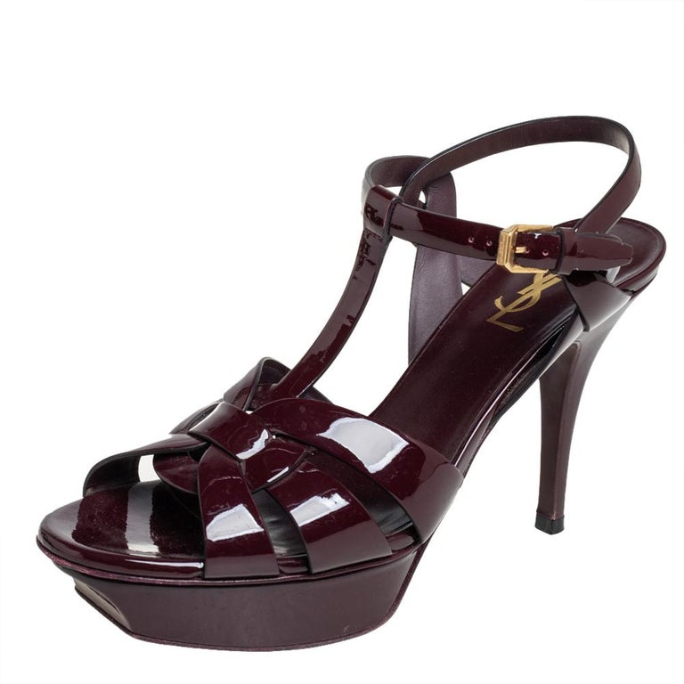 One of the most sought-after designs from Saint Laurent is their Tribute sandals. They are such a craze amongst fashionistas around the world, and it is time you own one yourself. These burgundy ones are designed with patent leather straps, ankle