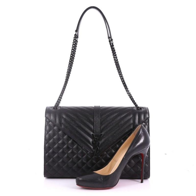 2b56d63a9 This Saint Laurent Classic Monogram Envelope Satchel Quilted Leather Large,  crafted from black quilted leather