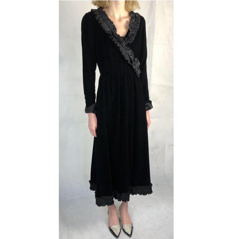 """Yves Saint Laurent said """" I love black because it affirms, designs, and styles. A woman in a black dress is a pencil stroke"""". Black liquid velvet material features with discretion , simplicity and refinement in the designer's opulent and iconic"""