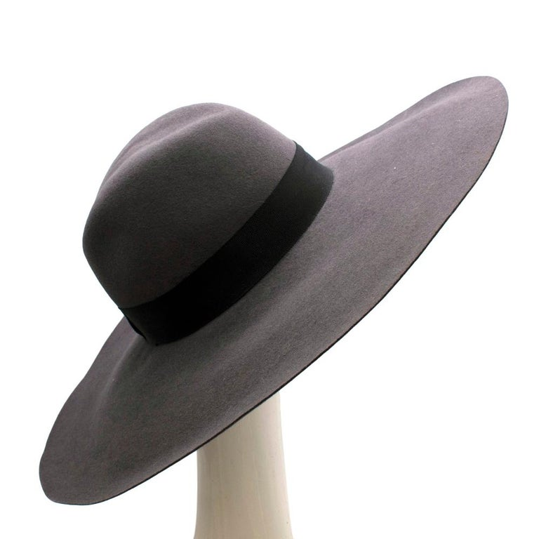 Saint Laurent Grey Rabbit Felt Floppy Fedora Hat   -Iconic YSL Wide style -Smooth and soft textured felt  -Black cotton ribbon  -Neutral color easy to combine   Materials: 90% rabbit felt, 10% cotton  Specialized cleaning only   Made in France
