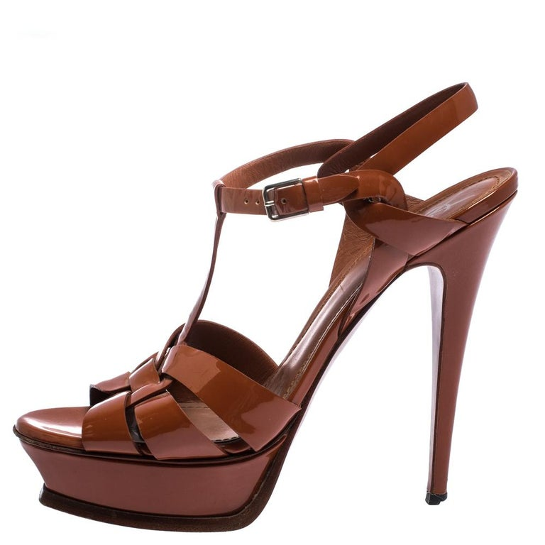 One of the most sought-after designs from Saint Laurent is their Tribute sandals. They are such a craze amongst fashionistas around the world, and it is time you own one yourself. These brown ones are designed with patent leather straps, ankle