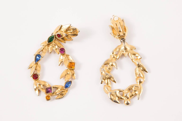 Saint Laurent drop gold-tone earrings featuring a clip on fastening, multi glass beads, back plaque logo YSL. Total Length:3,5in. (9cm) Width1,5in. (4cm)   In excellent vintage condition. Made in France.   We guarantee you will receive this gorgeous