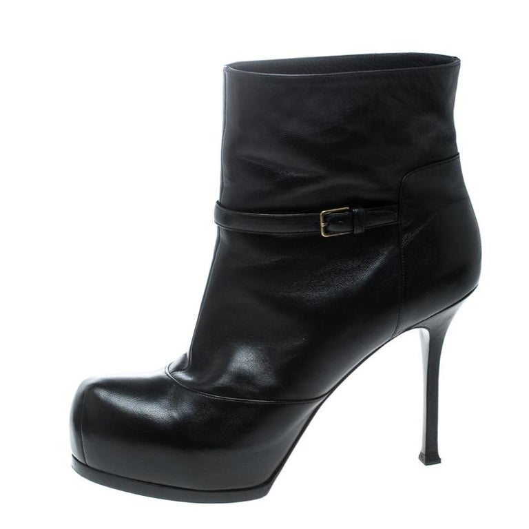 Durable and chic, these ankle boots from Saint Laurent Paris will cut an alluring silhouette from day to night. Crafted from leather, the ankle boots have belt details, concealed platforms, and 11 cm heels. They are complete with comfortable insoles
