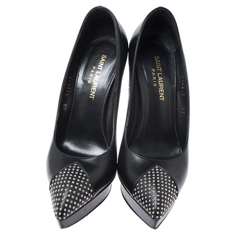These stunning pumps from the house of Saint Laurent Paris exude style and glamour. Crafted in Italy, they are made of leather and come in a classic shade of black. They feature pointed cap toes with small silver-tone stud detailing, 13 cm heels,