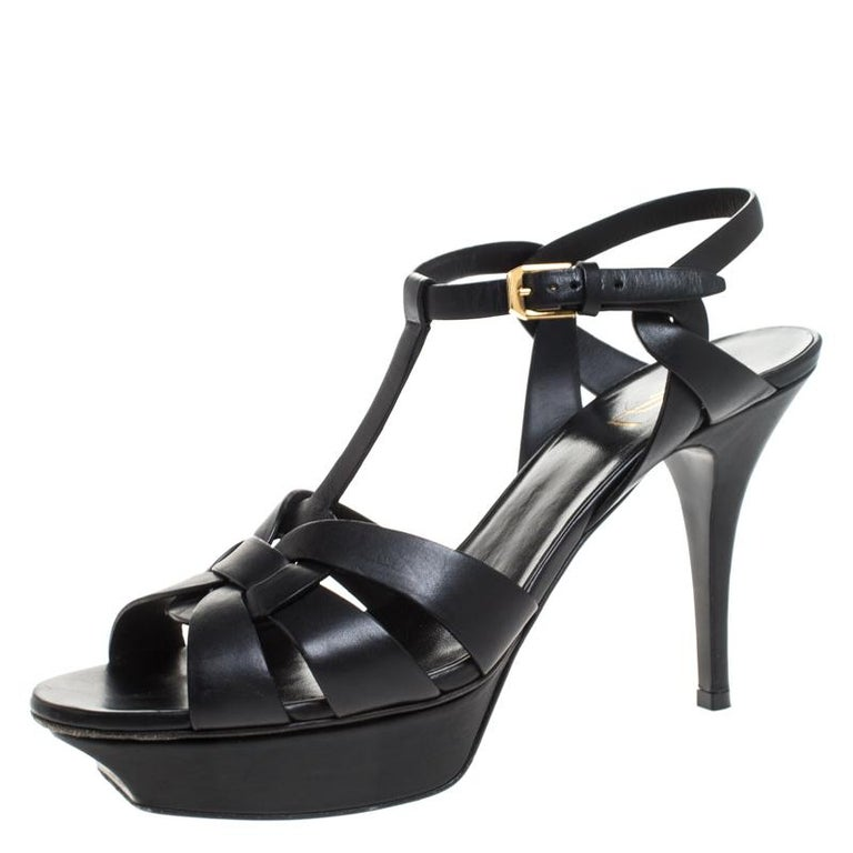 One of the most sought-after designs from Saint Laurent is their Tribute sandals. They are such a craze amongst fashionistas around the world, and it is time you own one yourself. These black ones are designed with leather straps, ankle fastenings