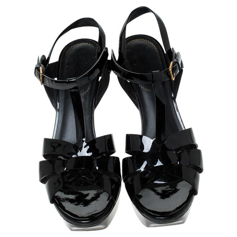 One of the most sought-after designs from Saint Laurent is their Tribute sandals. They are such a craze amongst fashionistas around the world, and it is time you own one yourself. These black ones are designed with patent leather straps, ankle