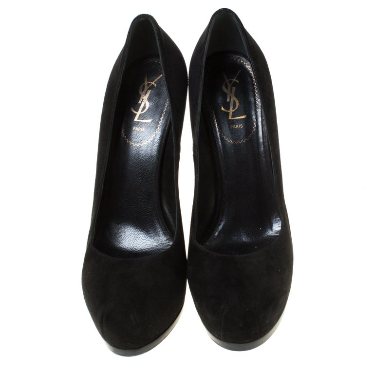 Fashionable and chic, these Tribtoo pumps from Saint Laurent will cut an alluring silhouette from day to night. Crafted from suede, the pumps have a black shade, concealed platforms, and 15.5 cm heels.  Includes: The Luxury Closet Packaging