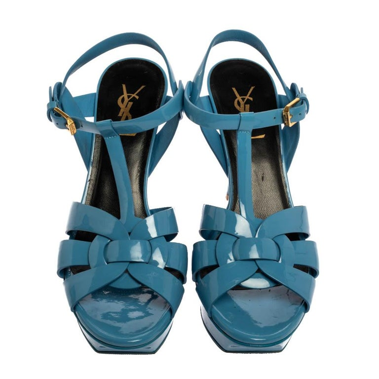 One of the most sought-after designs from Saint Laurent is their Tribute sandals. They are such a craze amongst fashionistas around the world, and it is time you own one yourself. These blue ones are designed with patent leather straps, ankle