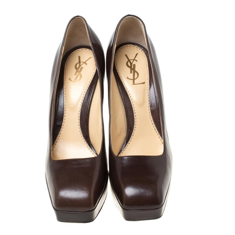 Crafted out of leather, these pumps are a charming add-on accessory that you absolutely need to own. Made by Saint Laurent Paris, this pair is the perfect mix of comfort and style. Wear these fabulously designed pumps in a classic brown shade to