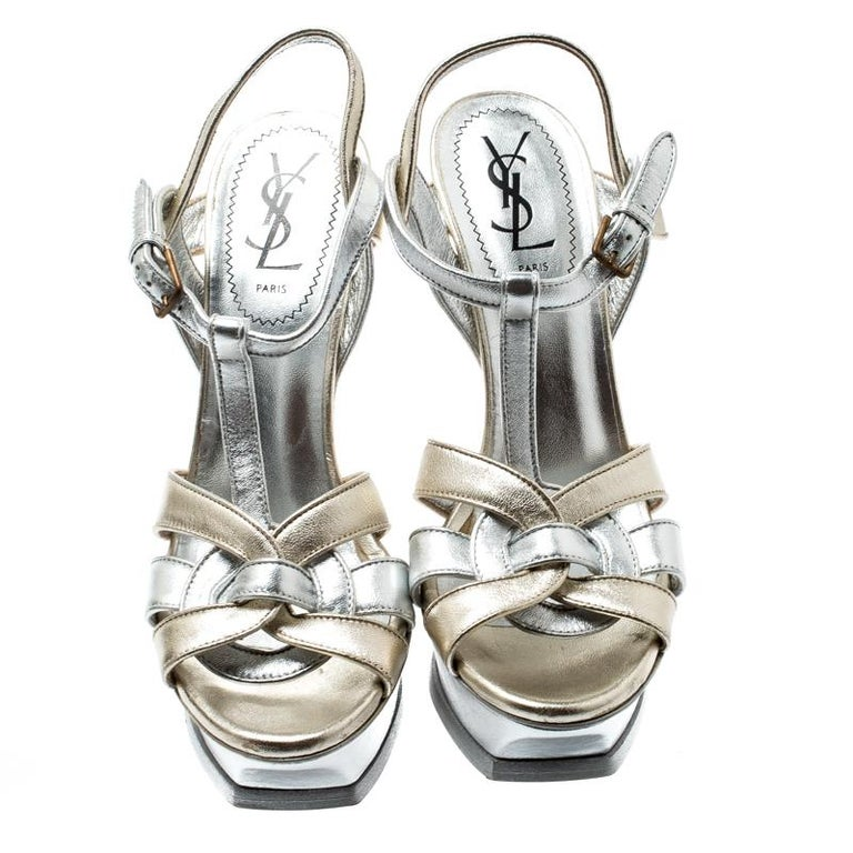 One of the most sought-after designs from Saint Laurent is their Tribute sandals. They are such a craze amongst fashionistas around the world, and it is time you own one yourself. These metallic ones are designed with leather straps, ankle