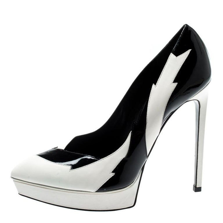 These uniquely designed pumps from Saint Laurent Paris are perfect to create easy neutral looks and also add to a coloured outfit for a balanced look. Constructed in black and white leather panels, Janis pumps feature a platform along with the high
