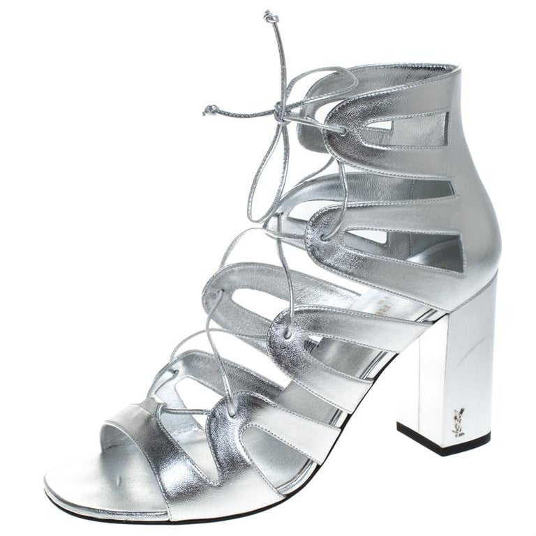 These sandals from Saint Laurent Paris will lend a stylish and playful edge to your feet. Look glamorous no matter what you wear, with these beautiful sandals. Crafted in Italy, they are made from quality leather and come in a lovely hue of silver.