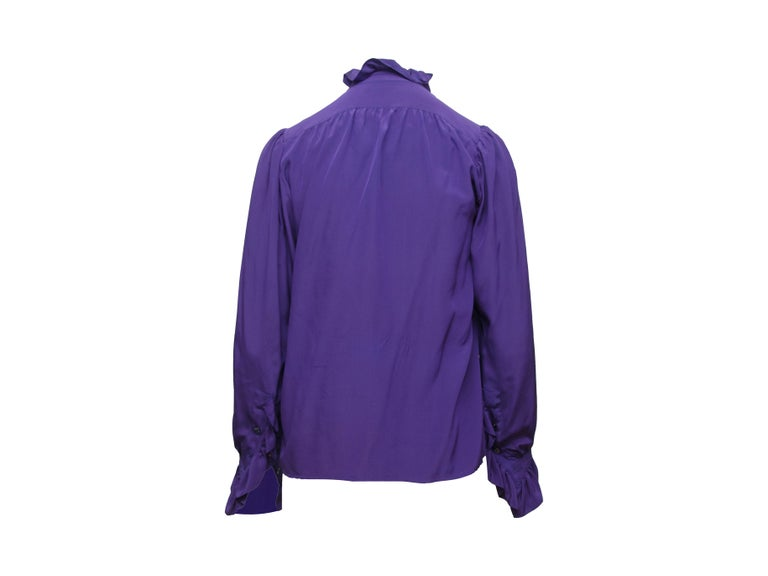 Product details: Vintage purple silk top by Saint Laurent. Ruffle trim throughout. High collar. Long sleeves. Button closures at bust. Designer size 36. 36