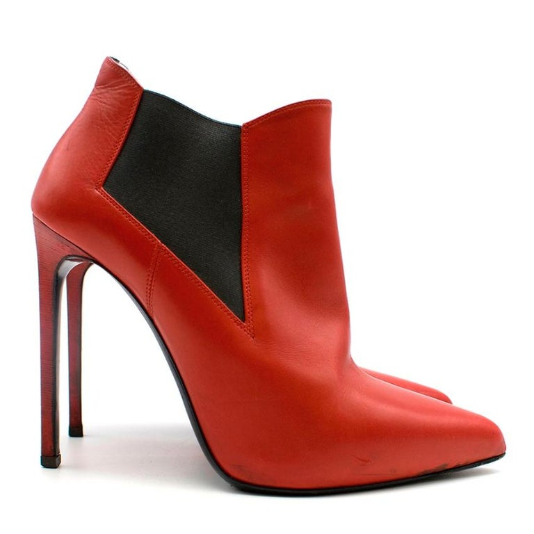 Saint Laurent Red Chelsea boot Heels with angled toe edge.  - Black side elastic panelling on outer side  - Pointed toe   Please note, these items are pre-owned and may show signs of being stored even when unworn and unused. This is reflected within