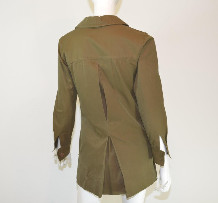 This Yves Saint Laurent vintage safari jacket was gifted to a Parisian model in 1969 and it is featured in a olive green color with a lace up tie fastening with four functional patch pockets. Jacket has button placements along the cuffs of the