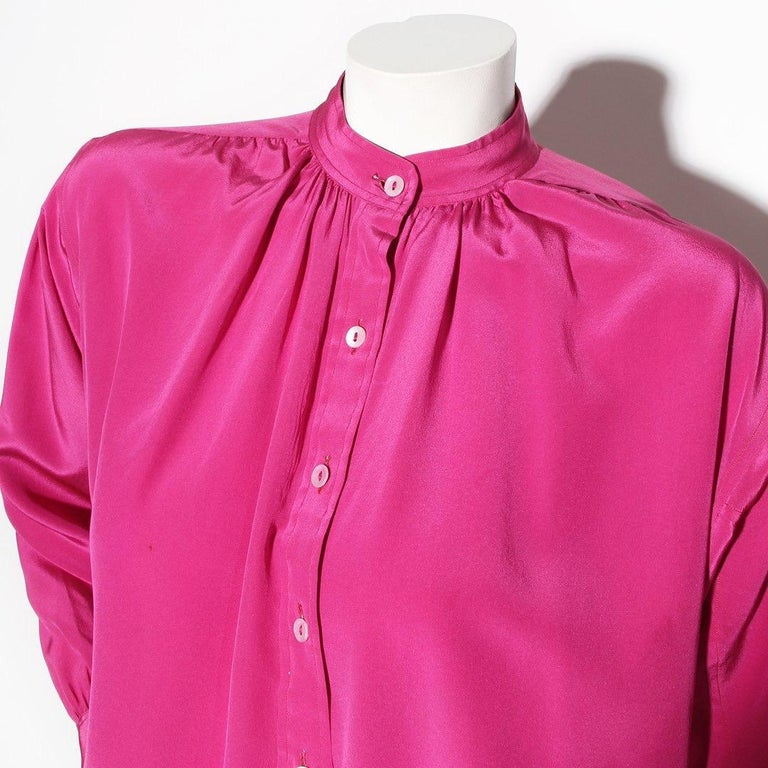Saint Laurent Rive Gauche Designer Blouse  Made in France Vintage  Circa 1980's  Fuchsia  100% Silk  Mandarin collar  Button-Up  Two buttons at cuffs of sleeve  Very good vintage condition; Preloved and vintage age with a very small discoloration on
