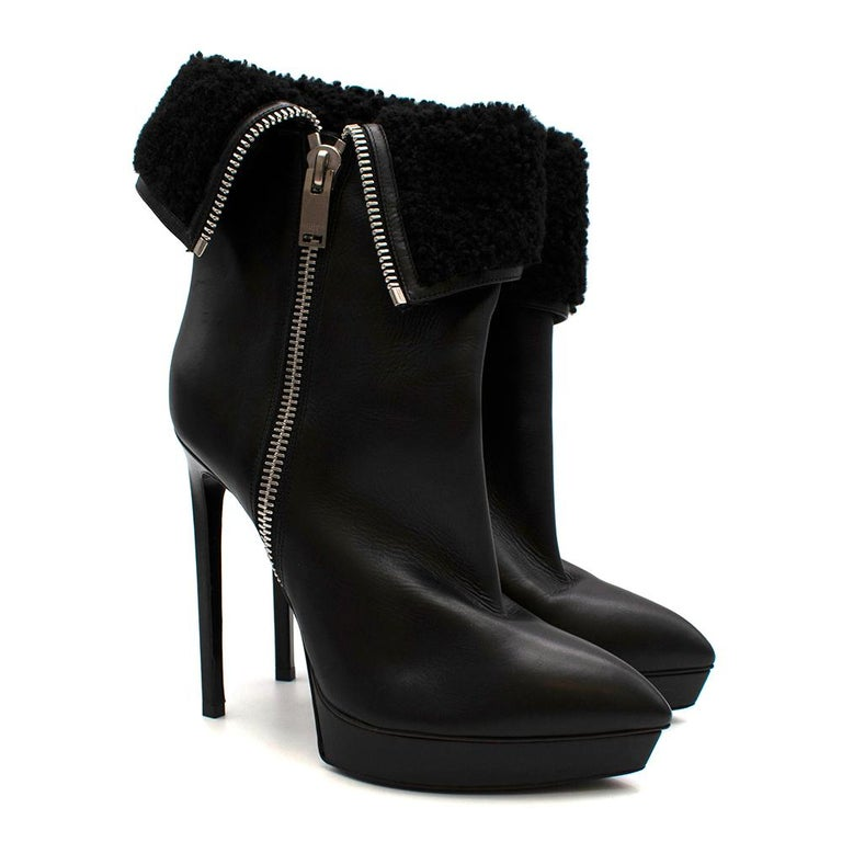 Saint Laurent Stiletto Shearling Lined Platform Boots  - Shearling with leather hemlines - Textured wet look leather lining - Silver chunky zip detailing on the outer leg - Shiny leather outer-sole - Pointy toe shape - Platform wedge - Squared