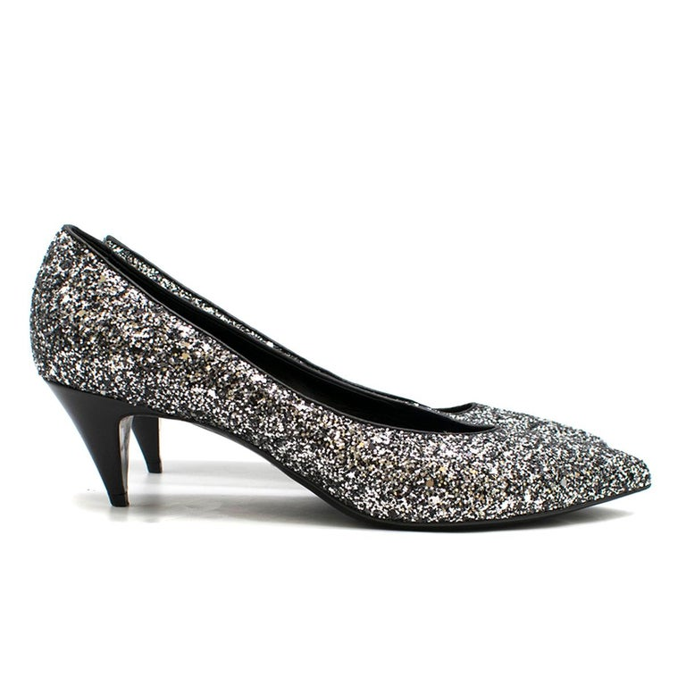 Saint Laurent Tara 55 Black Glitter Kitten Heel Pumps  - Silver & Black Pumps  - Glitter covered leather outer  - Point toe, slim toeline  - Black leather lining - 55 mm leather covered stiletto heel   Please note, these items are pre-owned and may
