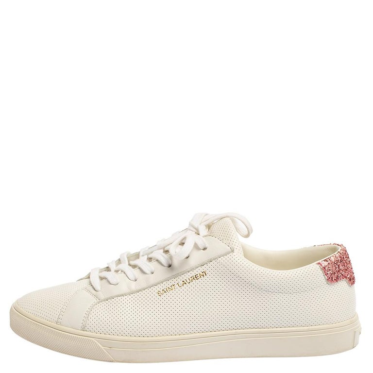 These Andy low-top sneakers from Saint Laurent are designed keeping minimal aesthetics in mind. They are crafted from white leather and to add a glamorous vibe to them, the counters are sprinkled with glitter. They feature round toes, lace-ups on