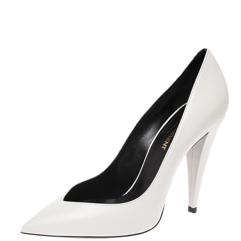 Your impeccable styling can never be complete without this pair of pumps from Saint Laurent. These pumps made from leather reflect the latest trends in fashion. This pair of white pumps feature pointed toes, sharp cuts and 11 cm heels.  Includes: