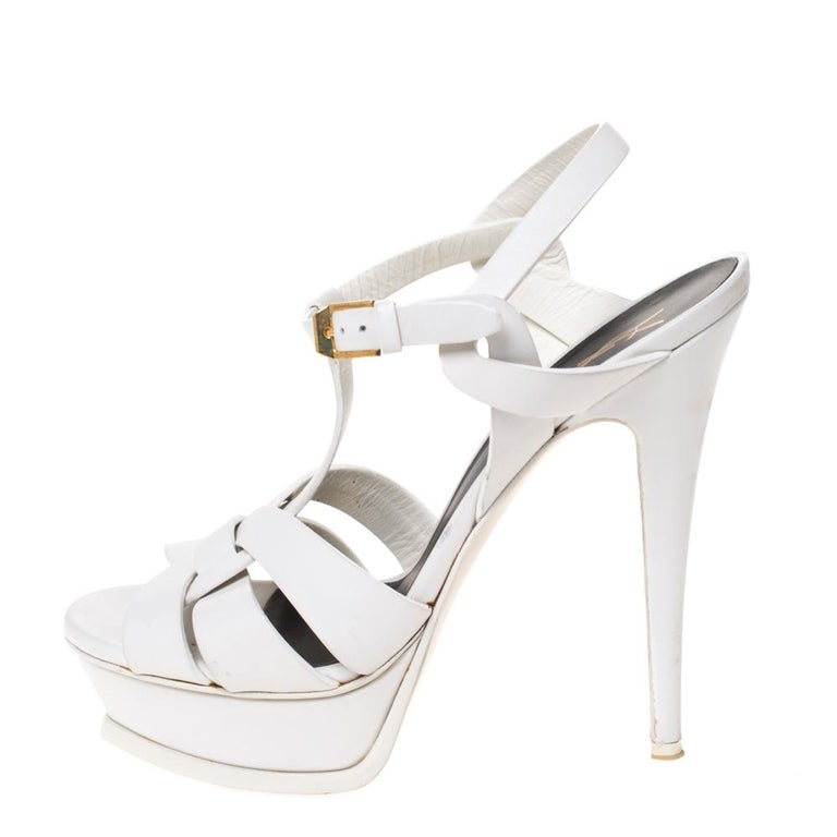 One of the most sought-after designs from Saint Laurent is their Tribute sandals. They are such a craze amongst fashionistas around the world, and it is time you own one yourself. These white ones are designed with leather straps, ankle fastenings