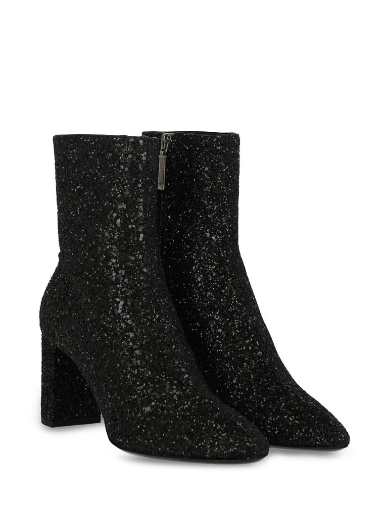 Product Description: Ankle boots, synthetic fibers, solid color, glittered effect, internal logo, side fastening, pointed toe, branded insole, branded sole, block heel, mid heel, leather lining.  Product Condition: Like New With