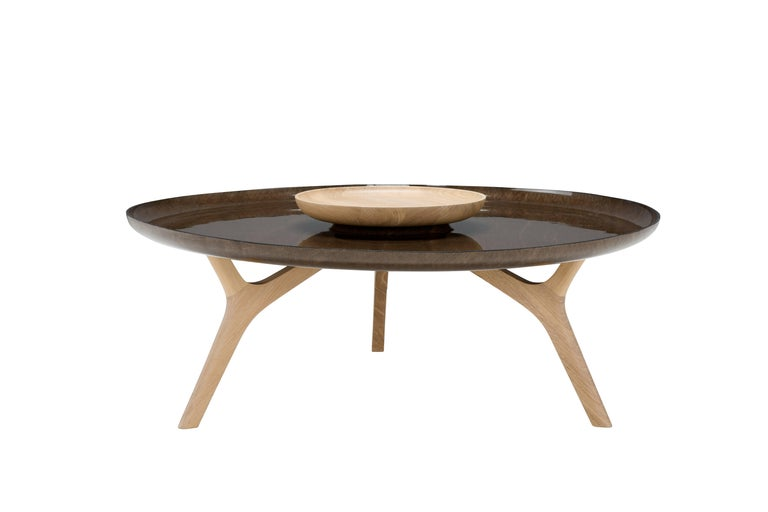 """Duales is an elegant coffee table in linen fibre and solid oak. Made of two overlapping """"trays"""", it has essential and clean lines that evoke lightness and solidity at the same time.  The use of solid oakwood underlines the naturalness of an object"""
