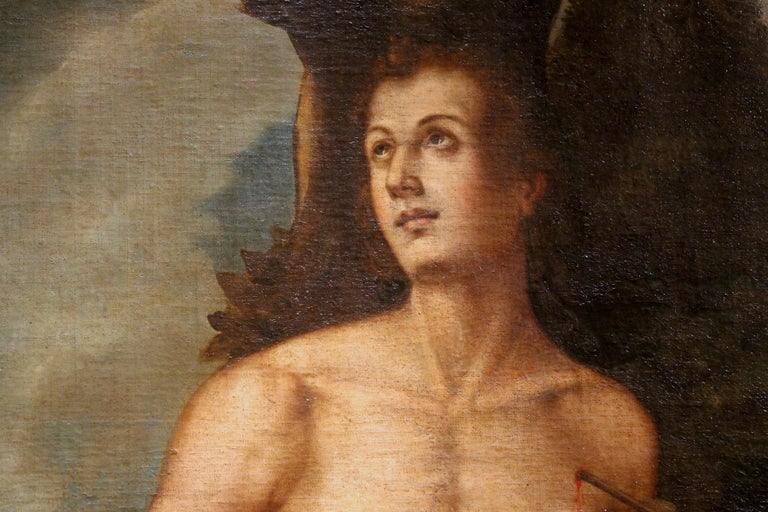 This antique Spanish School 17th century oil on canvas religious portait painting of Saint Sebastian is a symbol of rebirth and strength, so current and powerful that has become a gay icon and still contributes to redefine the perception of the
