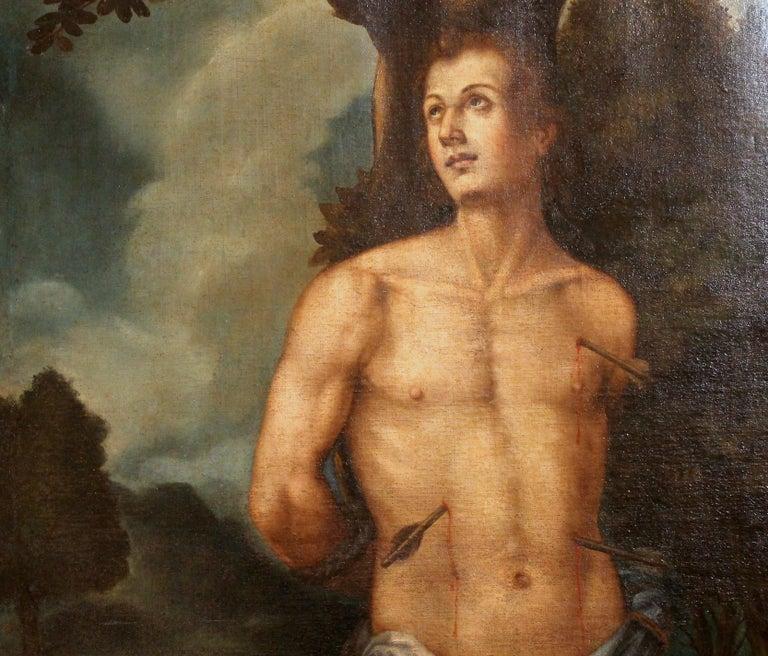 Walnut Saint Sebastian Spanish School 17th Century Oil on Canvas Religious Painting For Sale
