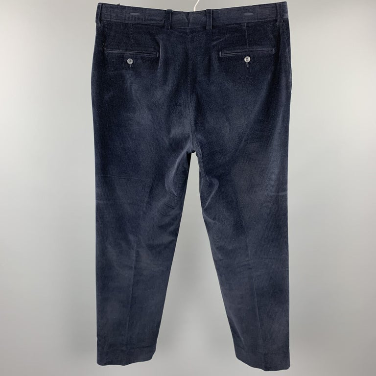 SAKS FIFTH AVENUE casual pants comes in a navy corduroy featuring a flat front and a zip fly closure.  Good Pre-Owned Condition. Marked: 36 R  Measurements:  Waist: 36 in.  Rise: 10 in.  Inseam: 32 in.   SKU: 103580 Category: Casual Pants  More
