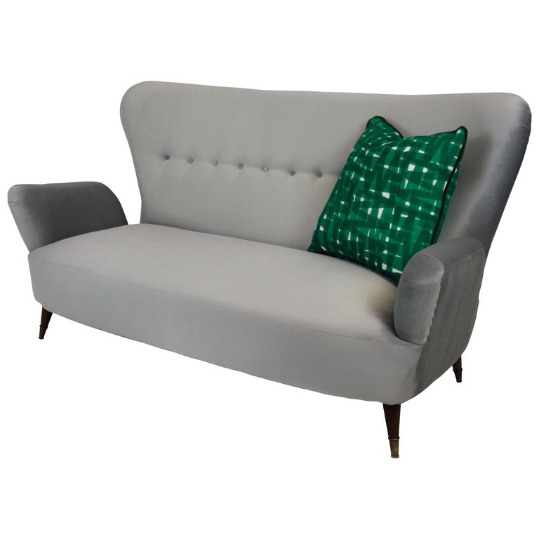 A stylish Italian sofa of good shape with tapering legs and brass sabot by Emilia Sala and Giorgio Madini (Designer), Fratelli Galimberti Cantù (Manufacturer). Newly upholstered in silver grey velvet, with seat cushions removed for better lines.