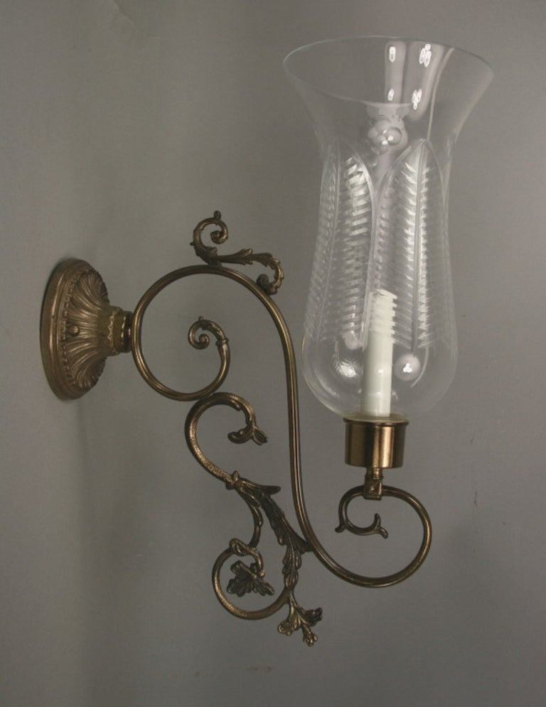 1-4004 a pair of finely ornate scrolled arm supporting a large cut-glass shade. Newly rewired Takes one 60 watt candelabra based bulbs.