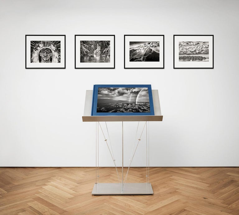 This Sumo-sized art edition (No. 301–400), designed by Lélia Wanick Salgado and signed by Sebastião Salgado, is presented with a clothbound companion volume, the signed print The Paraná connecting the Rio Negro with the Cuyuní river, state of