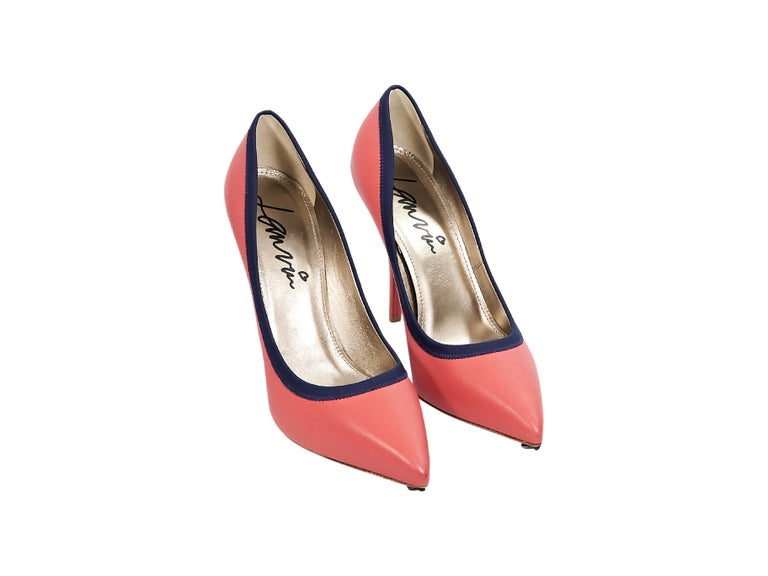 09cf5f0b4b Product details: Salmon leather pumps by Lanvin. Features navy blue trim.  Point toe