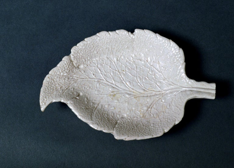 Salt-glazed stoneware sweetmeat dishes in the form of vine leaves, a pair, circa 1745-1765    The Staffordshire salt glaze stoneware dishes are molded in the form of a vine leaf and are curved at the top of the leaf and with a straight stem at
