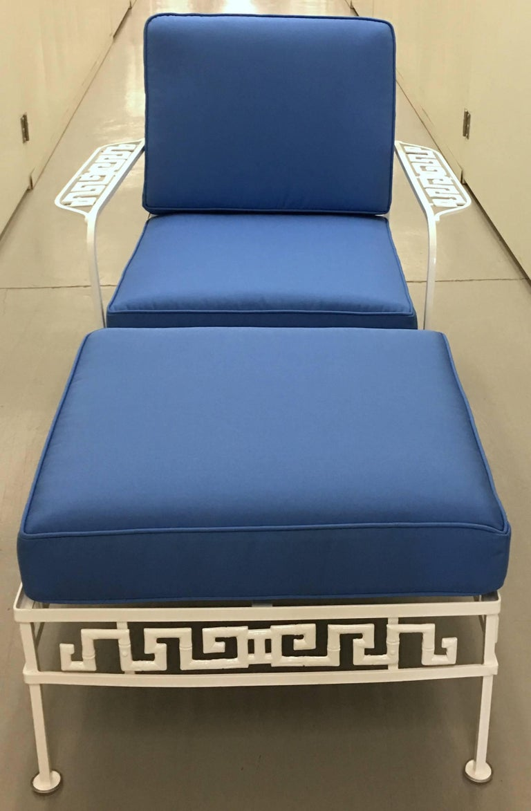 """Midcentury Salterini Greek key chair and ottoman. Newly powder coated in gloss white finish. New ocean blue canvas cushions. Suitable for indoor or outdoor use. Seat 15"""" H and 21"""" deep. Arm is 21"""" H. Ottoman 17"""" H x 23.5"""" W x 21.5"""" deep."""