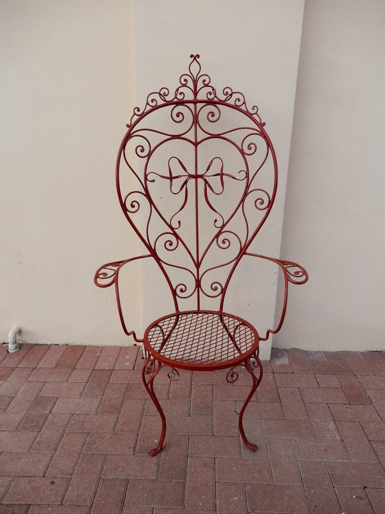 A wrought iron oversized armchair inspired by the work of  John Salterini. There is a known Salterini armchair with a large ribbon in the center of the back, the ribbon in the chair shown here is most similar or copy. The oversized chair is