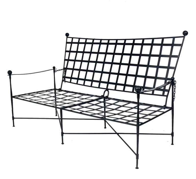 Iron settee or sofa, design attributed to Mario Papperzini for Salterini, Italian, circa 1950s. This is a versatile form and it can be used indoors or outdoors. This sculptural design was used by Yves Saint Laurent in his personal residence at la