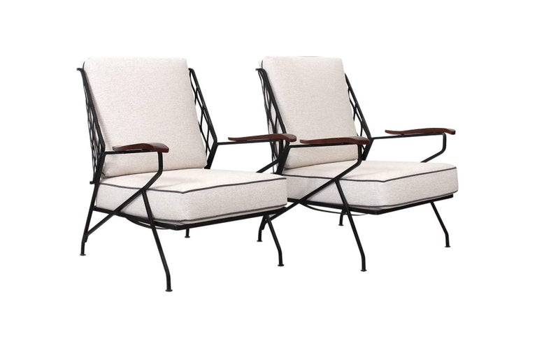 Rare pair of upholstered iron lounge chairs designed by Maurizio Tempestini for Salterini. Sculptural design with woven metal back and wooden arms suited for outdoor or interior use.