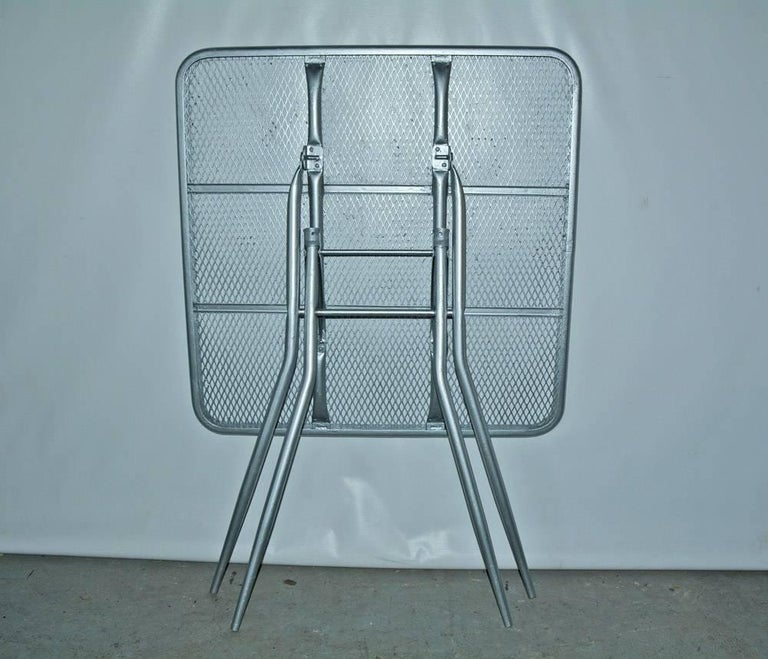 20th Century Salterini Mid-Century Modern Folding Metal Patio or Garden Table and Four Chairs For Sale