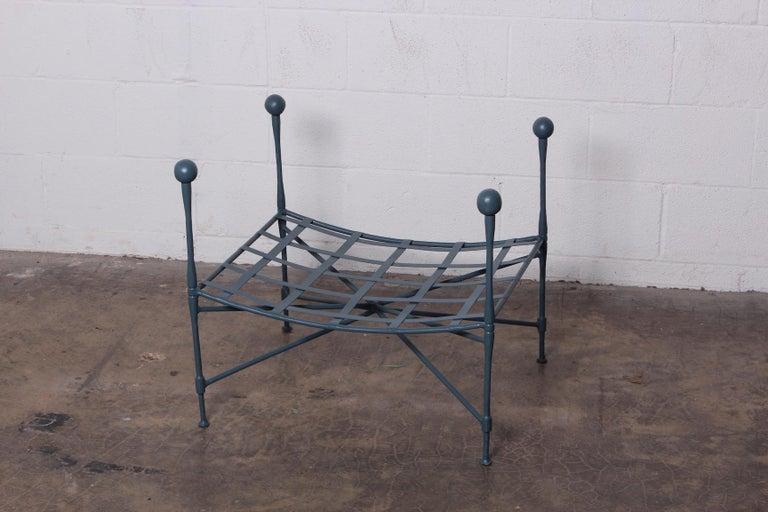 A Salterini sculptural iron lattice top ottoman with corner posts. Newly powder coated.