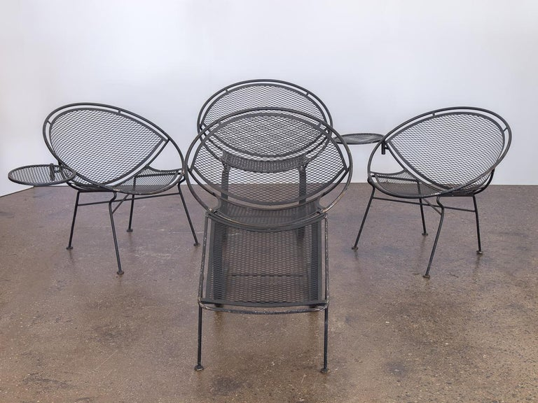 Georgeous set of wrought iron patio chairs designed by Maurizio Tempestini for Salterini. The set includes two chairs with a standard base in addition to two spring lounge chairs. The standard variations include detachable tables. The