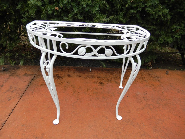 A vintage Salterini console table in the most desirable Della Robbia pattern. The table does have its original glass top shown in those light photos below. The console table is difficult to find and rarely appears in the marketplace. Other Salterini