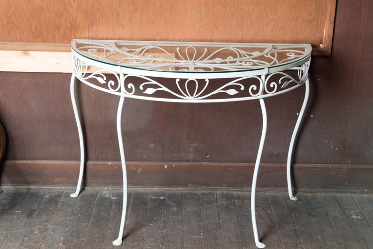 1940s fine quality wrought iron Salterini demi lune console table with glass top. Salterini was consider the best quality wrought iron garden furniture of the time.