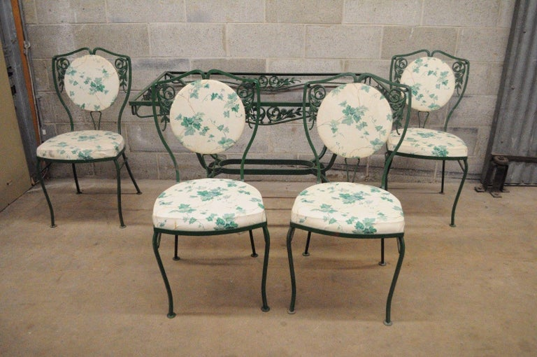 Five-piece vintage wrought iron patio dining set attributed to Salterini - no glass. Item features four chairs, rectangular table (no glass), upholstered back and seats, floral vine pattern, green painted finish, shapely legs, high quality iron