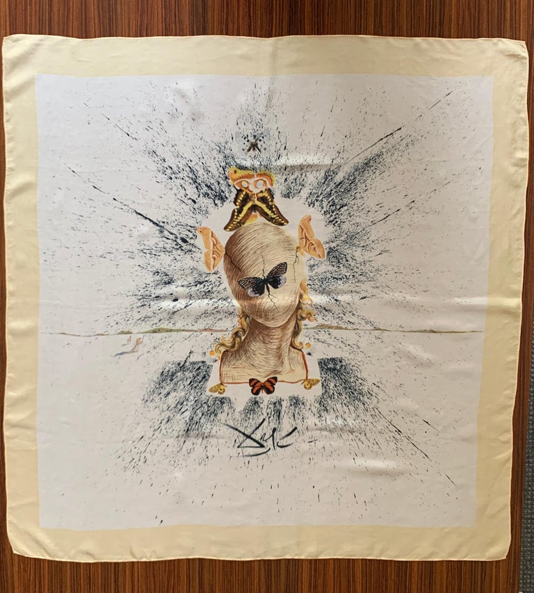 Amazing Salvador Dali silk scarf, designed for attendees of the International Silk Convention in 1957. Delicate silk features a surrealistic image of woman's head that has been wrapped in threads by a group of orange, gold, and grey silk moths,